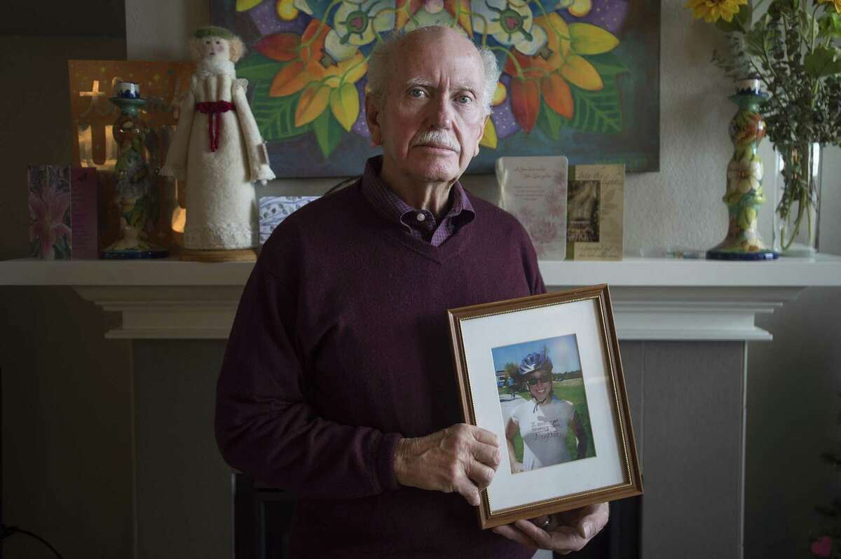 John Beerman poses for a portrait with a photo of his daughter, Theresa, at his home in Windsor, Colorado on Friday, January 19, 2018. Beerman and his family are concerned with Texas gun laws after Theresa bought a firearm and committed suicide in Dec. 2017. (Austin Humphreys/For the Houston Chronicle)
