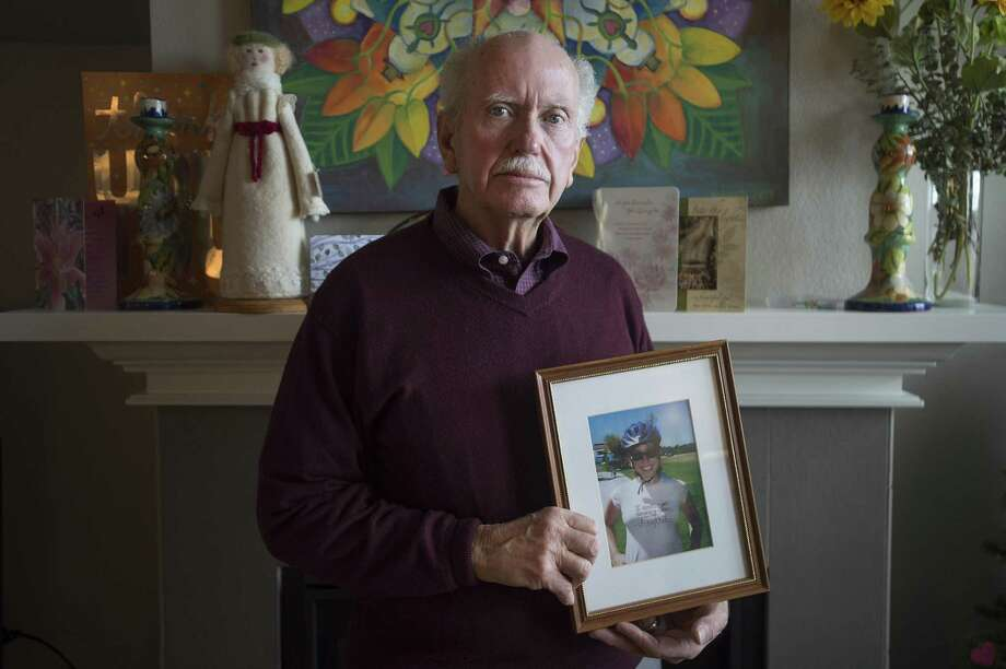 John Beerman poses for a portrait with a photo of his daughter, Theresa, at his home in Windsor, Colorado on Friday, January 19, 2018. Beerman and his family are concerned with Texas gun laws after Theresa bought a firearm and committed suicide in Dec. 2017. (Austin Humphreys/For the Houston Chronicle) Photo: Austin Humphreys/For The Houston Chronicle / Austin Humphreys/For the Houston Chronicle