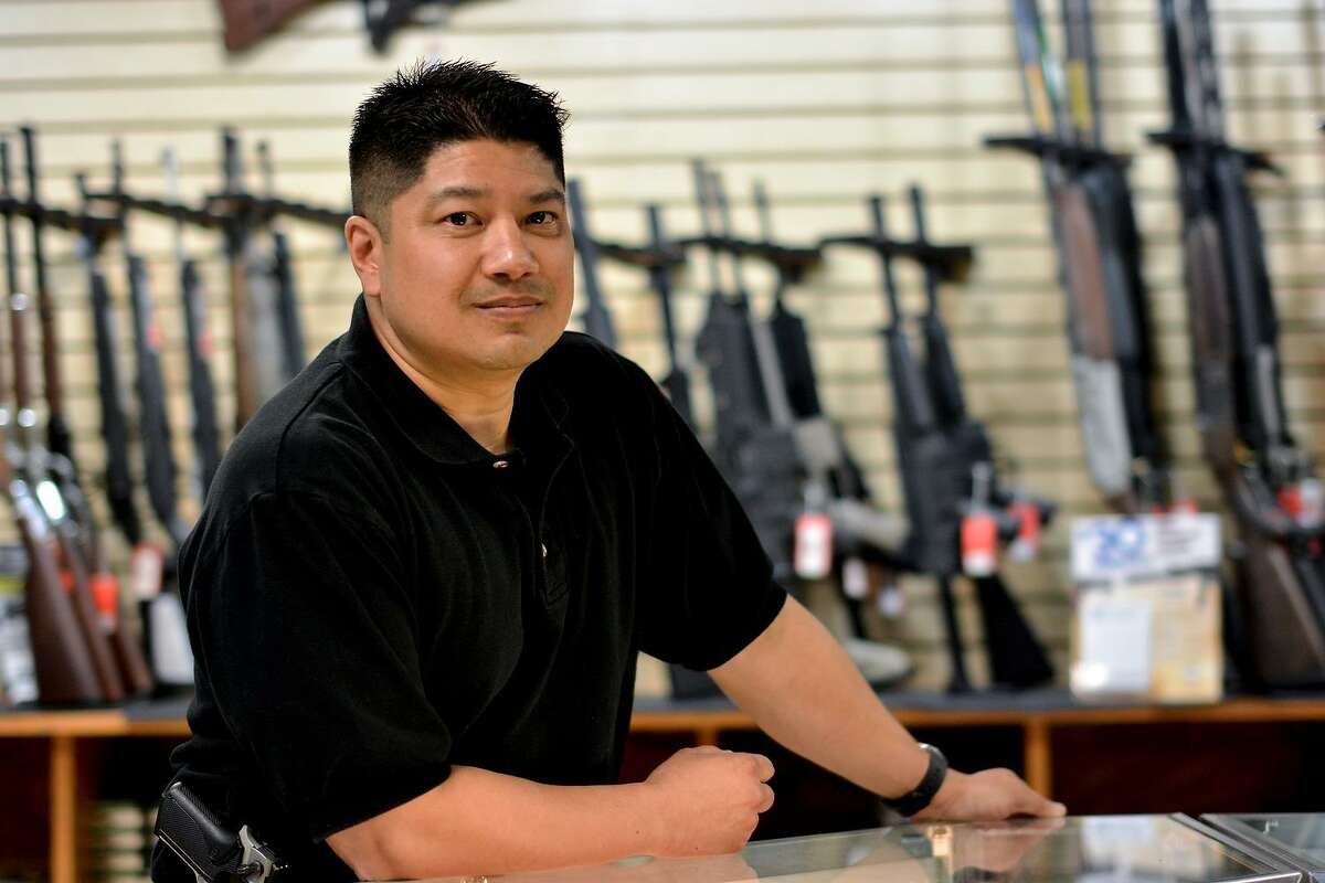 Ron Reyes, the owner of Discount Firearms and Ammo in Las Vegas, works at his store on June 30, 2014. One of his customer committed suicide with a gun on the store's gun range. Reyes said he still thinks about the incident and has made suicide prevention part of his job. Photo by Jacob Byk/News21.