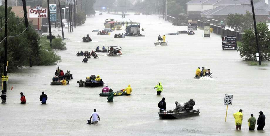 Houston residents are evacuated Aug. 28 as floodwaters from Tropical Storm Harvey swamp their neighborhood. This year, Texas is again woefully unprepared for hurricane season, which is predicted to be above average. Photo: David J. Phillip /Associated Press / Copyright 2018 The Associated Press. All rights reserved.