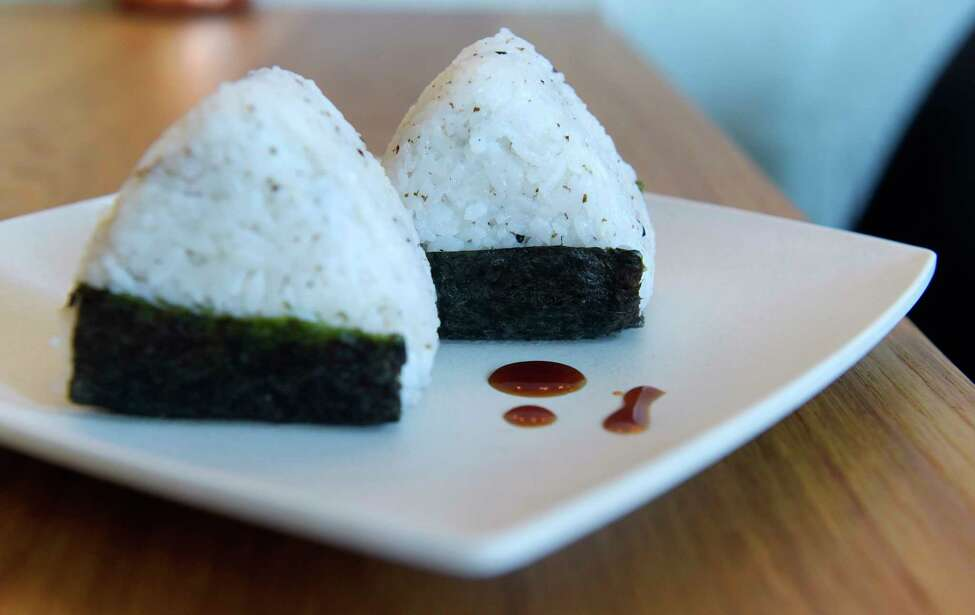 A view of two rice balls, one is a Ball of Creativity, which changes by the minute, kitchen's choice, and the other one is a Albacore Avo Ball, tuna salad, avocado, and spicy mayo. Photographed at The Little Rice Ball, located at 6 Franklin Place, on Wednesday, May 30, 2018, in Troy, N.Y. (Paul Buckowski/Times Union)