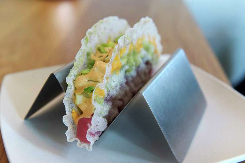 A view of Sashimi Taco, crispy fried rice paper filled with chef's choice. Pictured in this taco is ahi tuna, avocado, cucumber, spicy mayo, and scallions. Photographed at The Little Rice Ball, located at 6 Franklin Place, on Wednesday, May 30, 2018, in Troy, N.Y. (Paul Buckowski/Times Union)