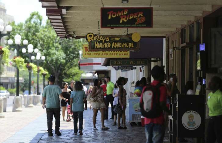 People near Ripley's Haunted Adventure across from the Alamo last June.  A major makeover of the area is headed for a City Council decision this week. (Kin Man Hui/San Antonio Express-News)