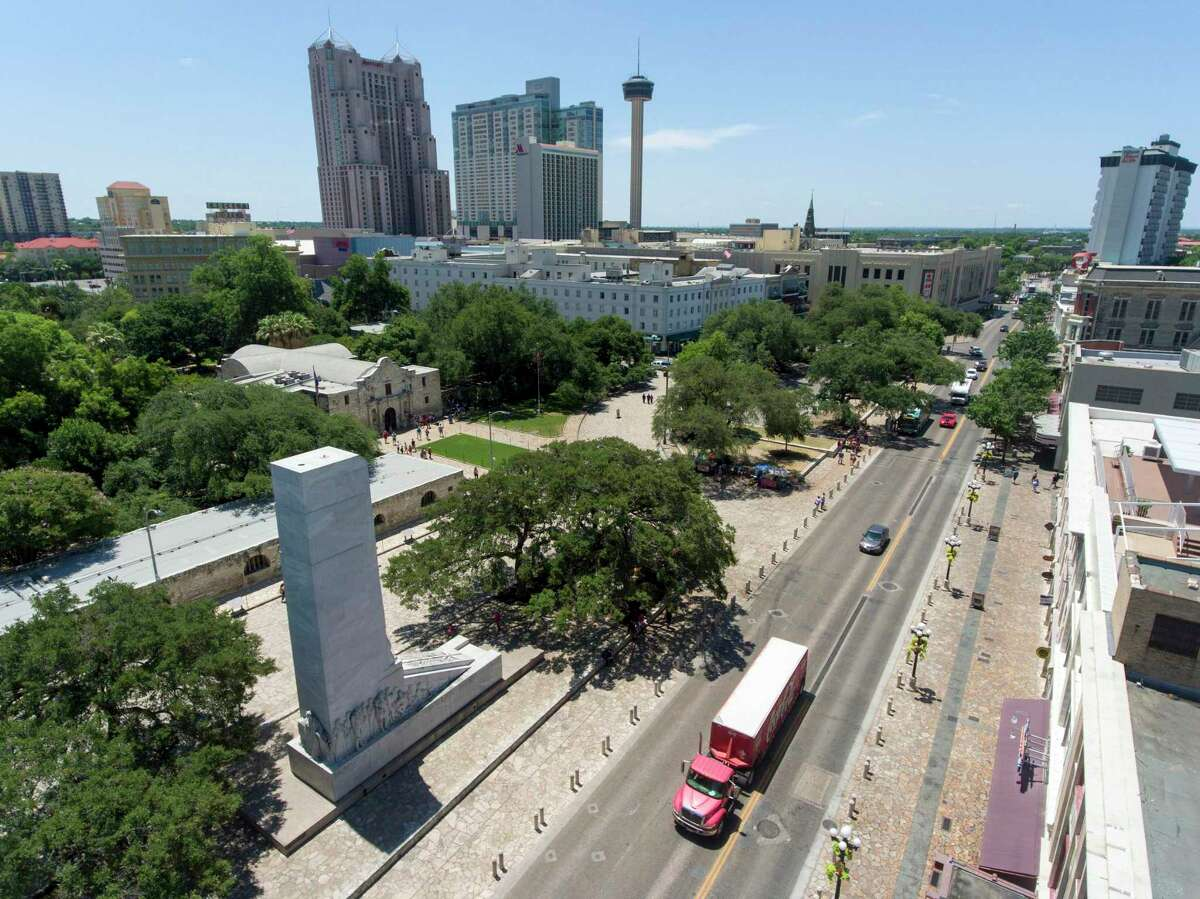 Vehicles drive east Thursday, June 7, 2018 on Alamo Street in front of the Alamo and the Cenotaph. A proposed Alamo Plaza renovation plan released Thursday calls for closing Alamo Street and moving the Cenotaph among numerous other changes.