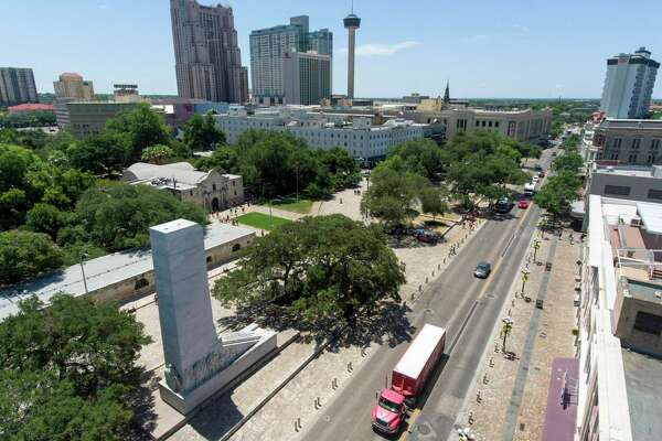 Vehicles drive north on Alamo Street in front of the Alamo and the Cenotaph. A proposed Alamo Plaza plan released Thursday suggests closing Alamo Street, from Commerce Street to a block north of Houston Street, and moving the Cenotaph about 500 feet south.