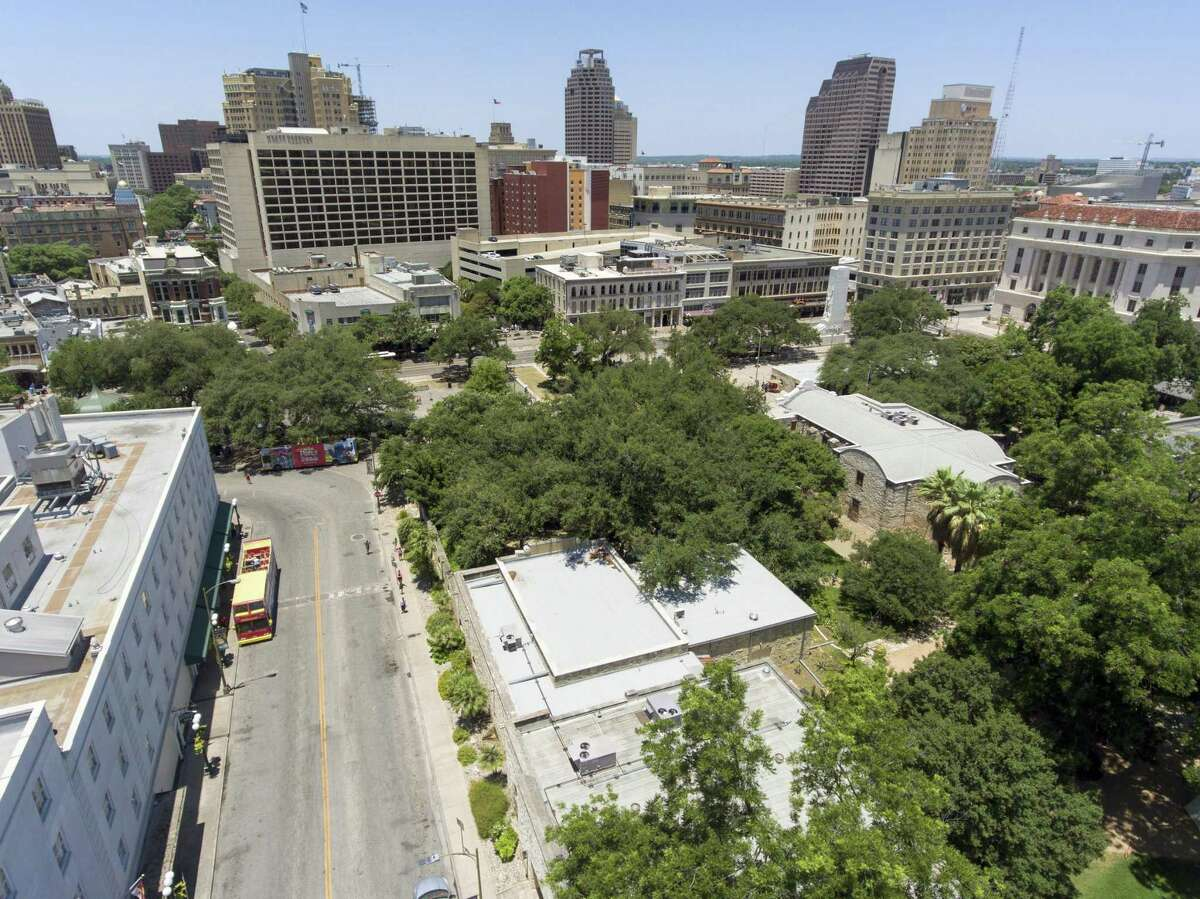 Crocket Street separates the Menger Hotel, left, from the Alamo and Alamo Plaza Thursday, June 7, 2018. A proposed Alamo Plaza renovation plan released Thursday calls for closing Crockett Street among numerous other changes.