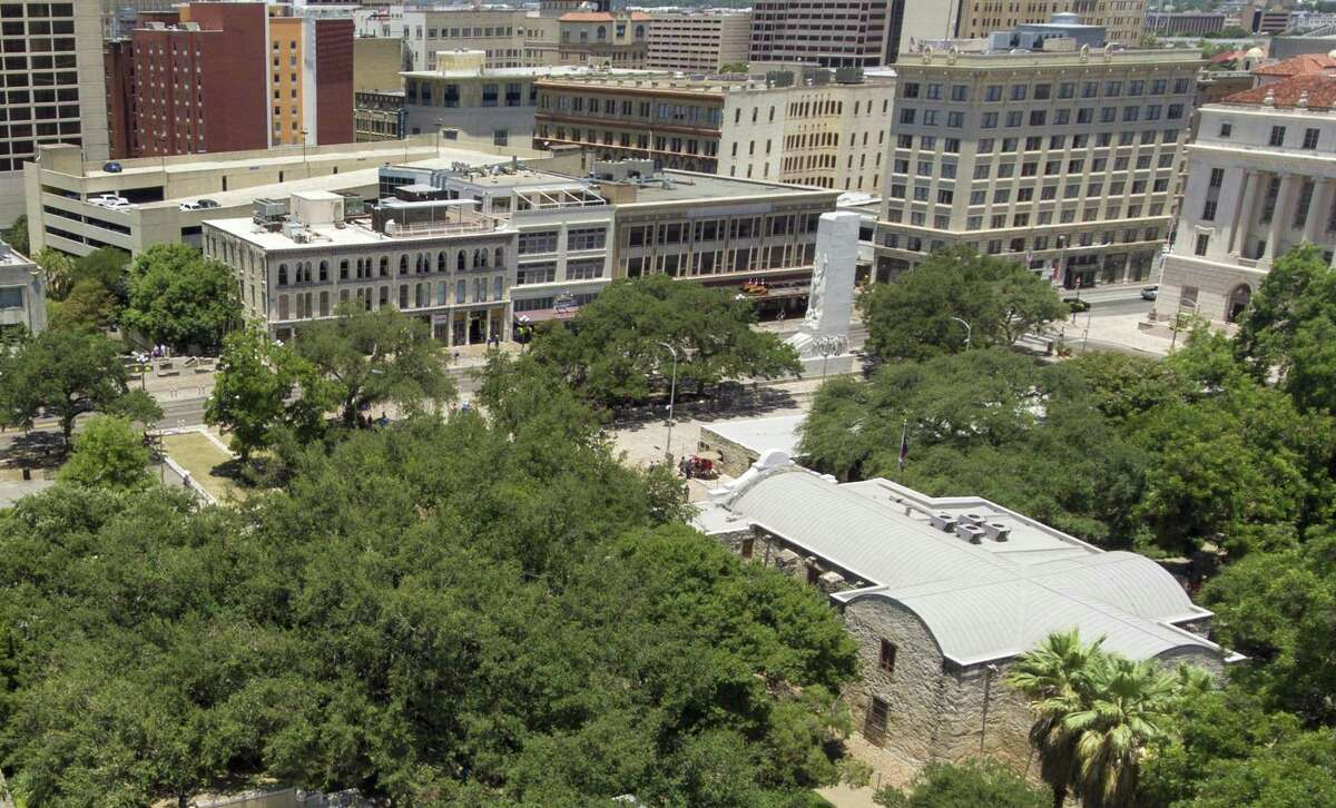 The Alamo is seen in front of the Cenotaph. A proposed Alamo Plaza plan released Thursday calls for moving the Cenotaph south, closer to the Menger Hotel, and potentially demolishing all or part of the historic buildings along Alamo Street to enlarge the plaza and make room for a museum and other battle features.