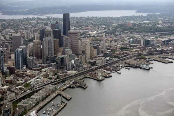 Downtown Seattle, the waterfront and viaduct are seen from the CoStar Group slow-speed research plane, May 31, 2018.