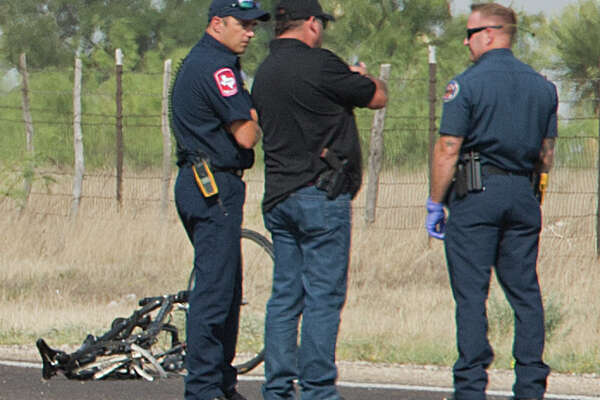 Midland police investigate a bicyclist that was hit and killed 06/07/18 morning by a car driving West on the northside 191 service road just East of County Road 1275. Tim Fischer/Reporter-Telegram