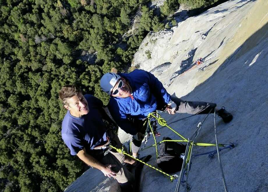 This provided photo shows Jason Wells, left, and Tim Klein during a climb along the Nose climbing route on El Capitan in Yosemite National Park, Calif. Family and friends say the two men who fell to their deaths while climbing El Capitan at Yosemite National park were elite climbers who partnered on routes since their college days in San Diego. The National Park Service has said, Wells and Klein were about 1,000 feet up the so-called Freeblast Route when they fell on Saturday June 2, 2018. (Greg Murphy via AP) Photo: Greg Murphy 2017