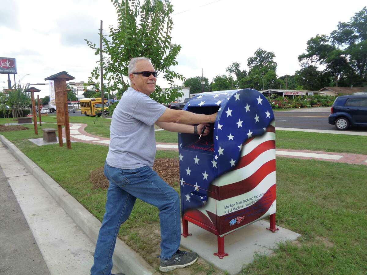 When Kimmy Wood and Keith Rowe met Dayton Enhancement Committee member Caroline Wadzeck at The Crossroads in Dayton for a photo op, Mark McClellan happened to show upto make a flag deposit from the American Legion.