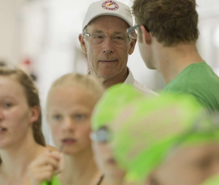 Ted Carson, former COM swim coach, talks with his swimmers 06/07/18 at the Frost Bank West Texas Invitational swim meet in COM. Tim Fischer/Reporter-Telegram Photo: Tim Fischer/Midland Reporter-Telegram