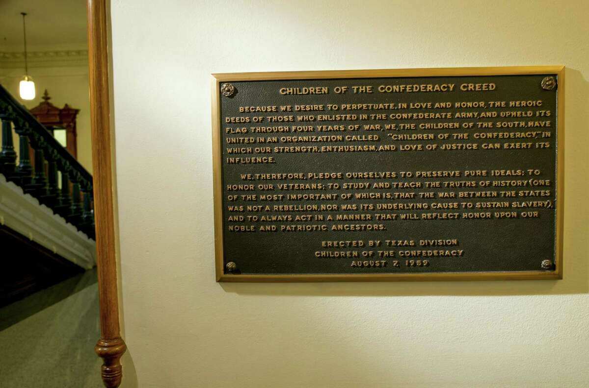 FILE - This Aug. 17, 2017 file photo shows, The Children of the Confederacy Creed plaque at the Capitol in Austin, Texas, on Thursday August 17, 2017. A black Texas lawmaker says Republican Gov. Greg Abbott privately told him he supports removing a Confederate marker in the state Capitol that rejects slavery as an underlying cause of the Civil War. An Abbott spokeswoman Friday stopped short of saying the plaque would come down. Ciara Matthews says the governor will ask state officials to look into the issue. (Jay Janner/Austin American-Statesman via AP File)