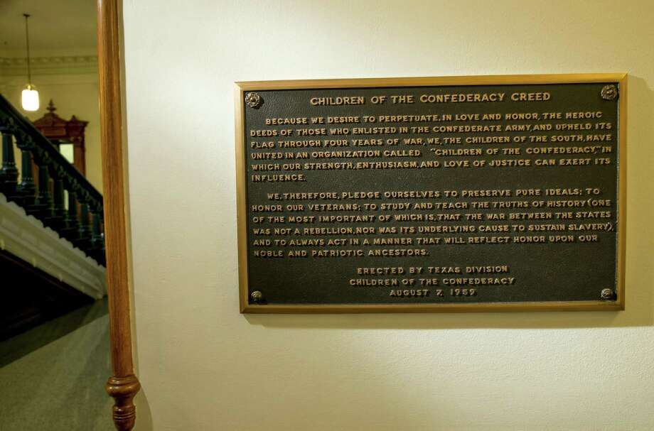 FILE - This Aug. 17, 2017 file photo shows, The Children of the Confederacy Creed plaque at the Capitol in Austin, Texas, on Thursday August 17, 2017. A black Texas lawmaker says Republican Gov. Greg Abbott privately told him he supports removing a Confederate marker in the state Capitol that rejects slavery as an underlying cause of the Civil War. An Abbott spokeswoman Friday stopped short of saying the plaque would come down. Ciara Matthews says the governor will ask state officials to look into the issue. (Jay Janner/Austin American-Statesman via AP File) Photo: Jay Janner, MBO / AP / Austin American Statesman