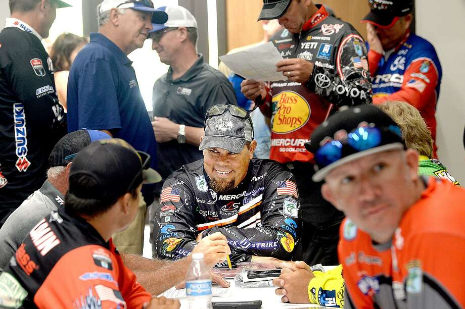 Anglers, including last year's winner Chris Lane (center), joke with one another as they gather for an orientation after registering before the opening of the Bassmaster Elite Series fishing tournament in Orange. The event, which was postponed in April due to weather, opens today and continues through the weekend. Photo taken Wednesday, June 6, 2018 Kim Brent/The Enterprise Photo: Kim Brent / The Enterprise / BEN