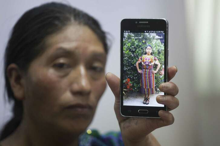 Dominga Vicente shows a photo of her niece, 20 year-old Claudia Patricia Gomez Gonzalez, who was allegedly killed by an agent of the U.S. Border Patrol in Nuevo Laredo, Texas, on Wednesday, during a press conference at the National Migrants Commission headquarters in Guatemala City, Friday, May 25, 2018. The family of Gomez Gonzalez, of the Mam indigenous community and natives of San Juan Ostuncalco, Guatemala, are asking for justice in her death. (AP Photo/Moises Castillo)