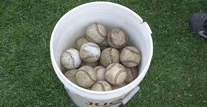 Greenwich 15 May 2000 - Baseballs sit in a bucket at the Brunswick FAA playoff game.  Photo/Mel Greer  COLOR