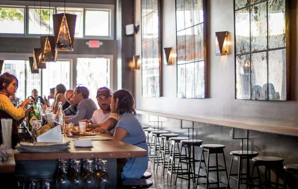 People enjoy cocktails at ABV in San Francisco, Calif., on Thursday, August 22nd, 2014.