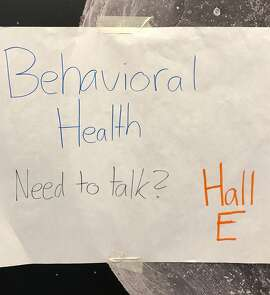 A handmade sign at the George R. Brown Convention Center guides those struggling with mental illness to help in early days after Hurricane Harvey. Those with the most severe illnesses were left untreated or under-treated because doctors did not have the proper medicine.