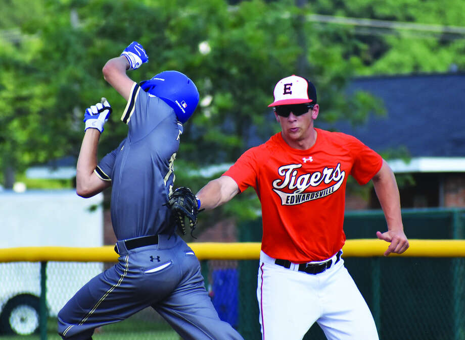 Edwardsville first baseman Matt Stopka tags out the St. Louis Pirates runner after a throw pulled him off of first base during a game Thursday at Tom Pile Field.