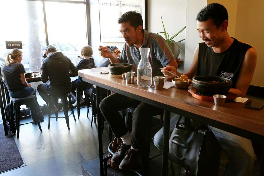 From left: Jake Pese and Jinji Zhang at Namu Stonepot. Photo: Santiago Mejia / The Chronicle