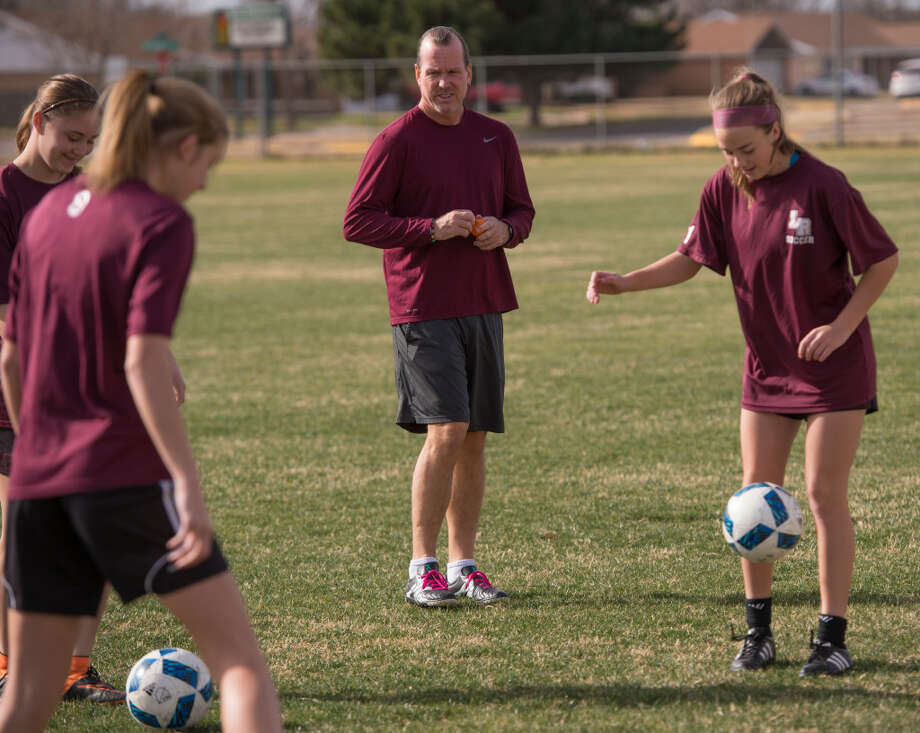 In this Jan. 3, 2017 file photo, Lee girls soccer coach Mark Hinshaw works with his players during practice.