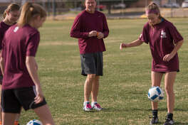 In this Jan.3, 2017 file photo, Lee girls soccer coach Mark Hinshaw works with his players during practice.