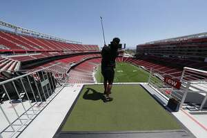 49ers running back Raheem Mostert watches his shot at Levi's Stadium during Thursday's ceremonial first tee for the three-day Stadiumlinks stop in the South Bay. During the competition, which begins its three-day run in Santa Clara on Friday, golfers will tee off from around the stadium toward nine holes on the field below.