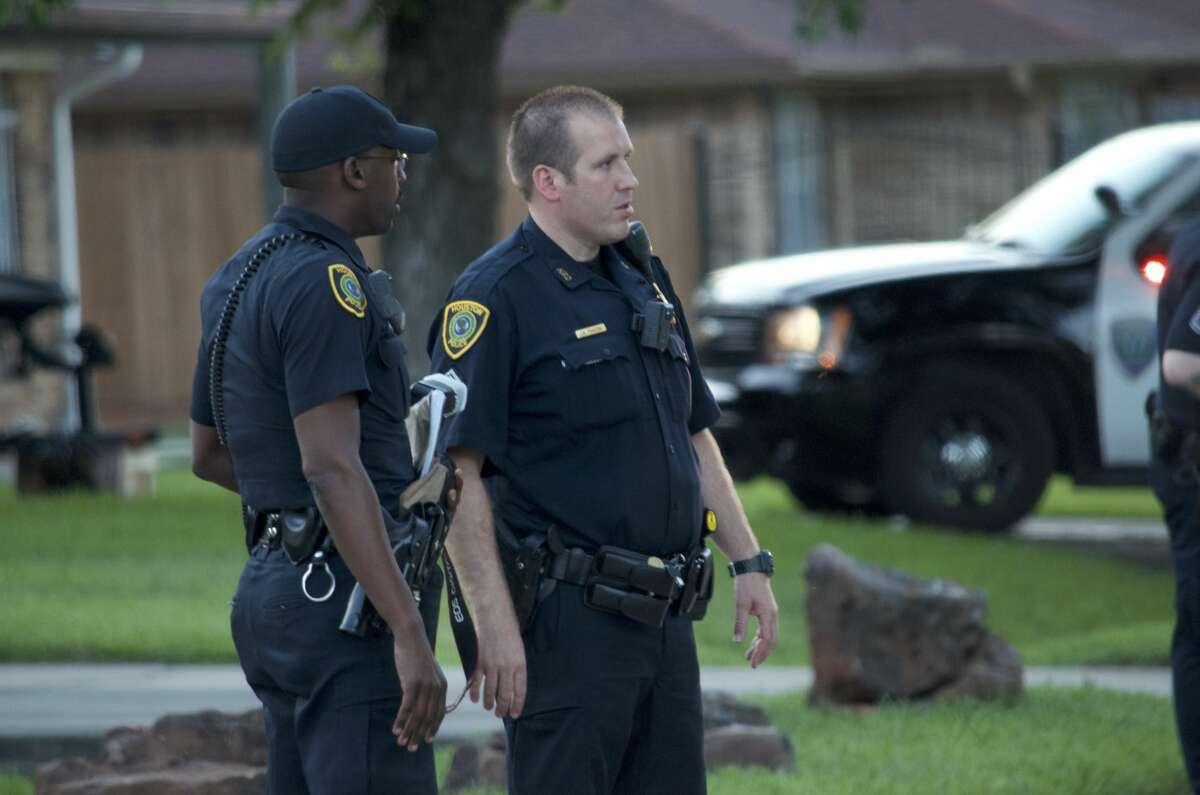 Houston police officers investigate a shooting in the 4400 block of Cetti Street on Thursday, June 7, 2018.