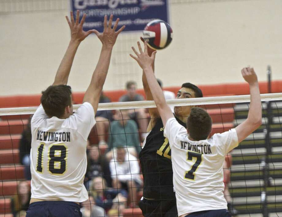Barlow's Matthew Cruz (10) spikes the ball over Newington's Teddy Fravel (18) and Daniel Cloutier (7) in the Connecticut Class M boys volleyball state championship final between Newington and Joel Barlow high schools, Thursday, June 7, 2018, at Shelton High School, Shelton, Conn. Newington defeated Joel Barlow 3 games to two to win the state Class M championship. Photo: H John Voorhees III / Hearst Connecticut Media / The News-Times