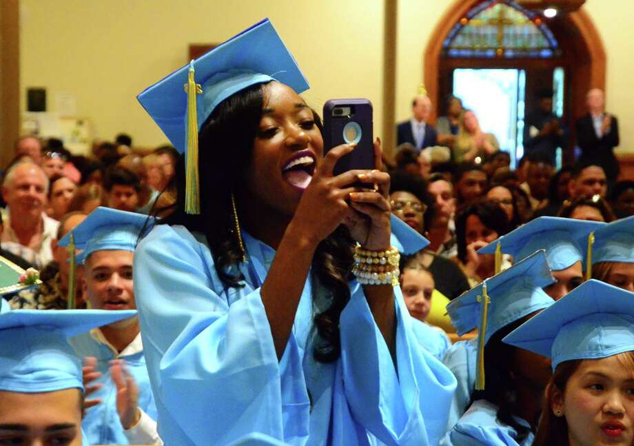 Graduate Chastity Kennedy cheers for a fellow graduate during Kolbe Cathedral's 2018 Commencement Exercises in Bridgeport, Conn., on Thursday, June 7, 2018. Photo: Christian Abraham, Hearst Connecticut Media / Connecticut Post