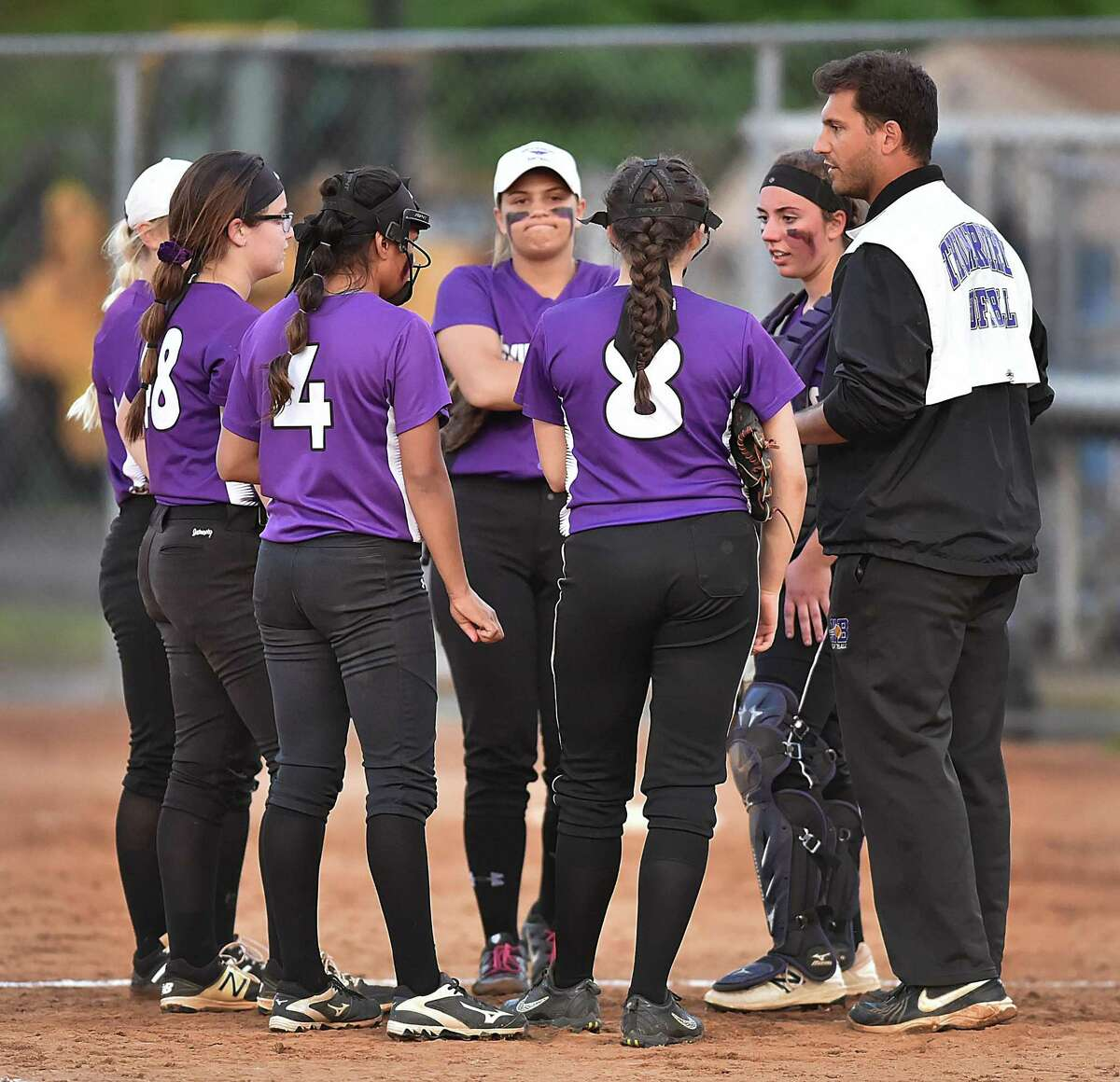 North Branford coach Nick DeLizio visits the mound in the top of the seventh inning against Griswold in the Class M softball semifinals on Thursday.