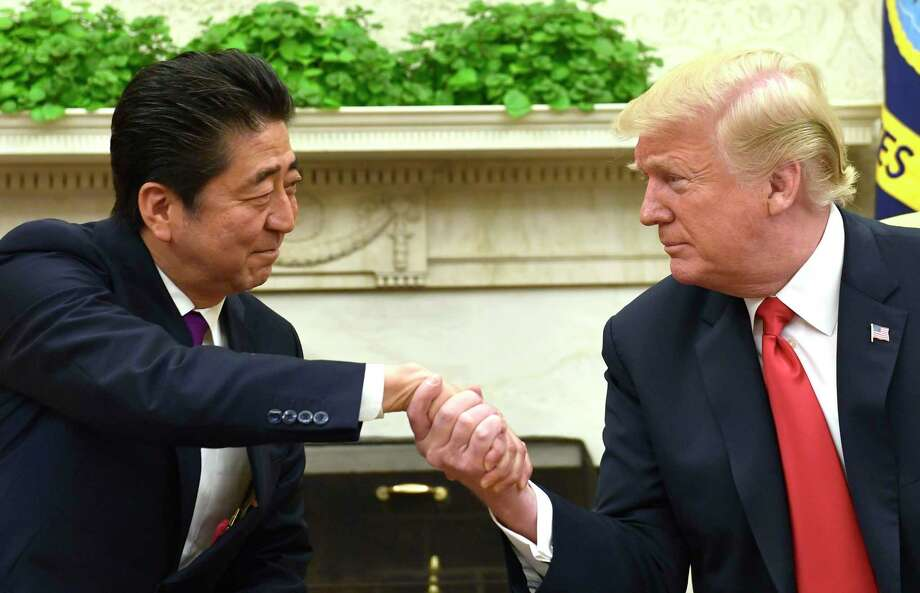 President Donald Trump shakes hands with Japanese Prime Minister Shinzo Abe in the Oval Office of the White House in Washington, Thursday, June 7, 2018. (AP Photo/Susan Walsh) Photo: Susan Walsh / Copyright 2018 The Associated Press. All rights reserved.