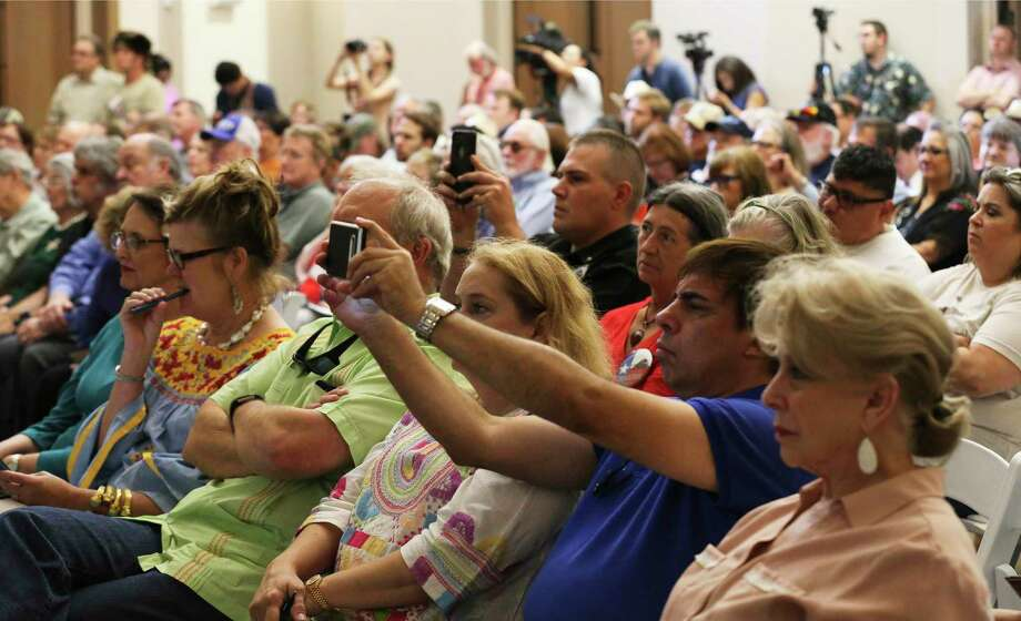 A sizable public audience pays attention to a presentation by landscape architects Reed Hilderbrand as a draft design for Alamo Plaza will be presented publicly for the first time at an Alamo Citizen Advisory Committee Meeting, June 7, 2018. A reader views the new Alamo Plaza plan as a threat to what makes the city unique. Photo: Kin Man Hui /San Antonio Express-News / ©2018 San Antonio Express-News
