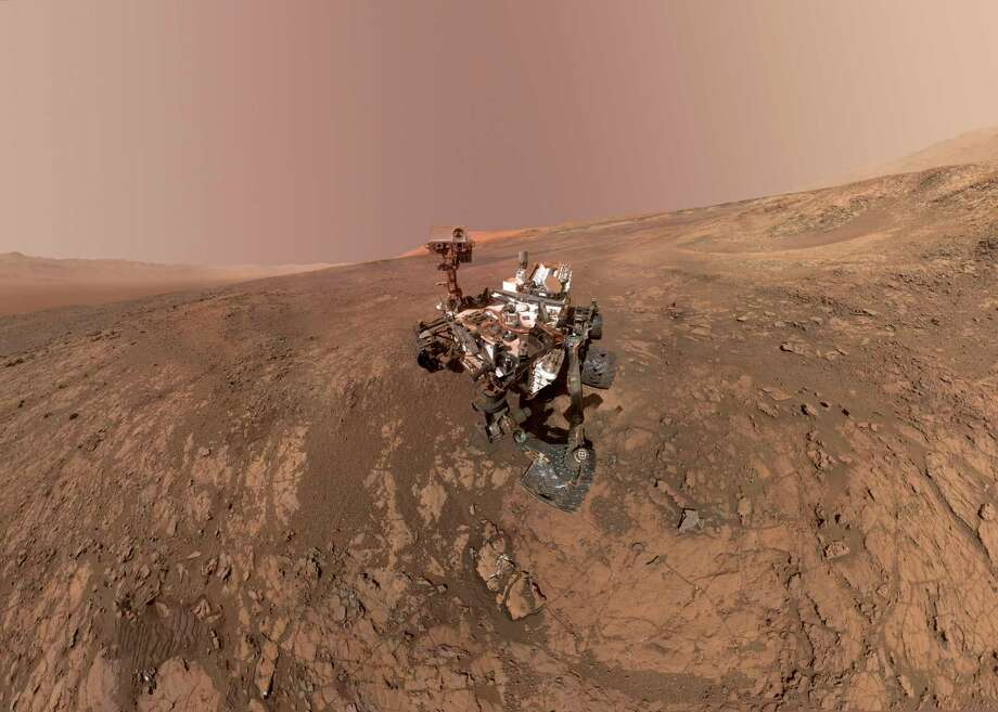 FILE - This composite image made from a series of Jan. 23, 2018 photos shows a self-portrait of NASA's Curiosity Mars rover on Vera Rubin Ridge. On Thursday, June 7, 2018, scientists said the rover found potential building blocks of life in an ancient lakebed and confirmed seasonal increases in atmospheric methane. The rover's arm which held the camera was positioned out of each of the dozens of shots which make up the mosaic. (NASA/JPL-Caltech/MSSS via AP) / NASA/JPL-Caltech/MSSS