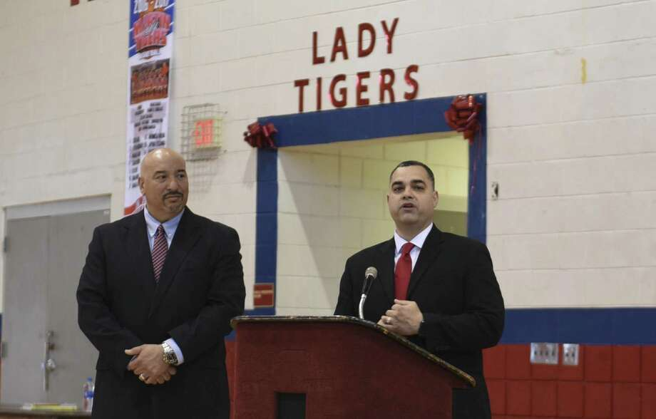 Martin High School principal Guillermo Pro, left, introduced the Lady Tigers' next girls' basketball coach in Rene Rodriguez Jr. Thursday at the MHS gym. Photo: Danny Zaragoza /Laredo Morning Times