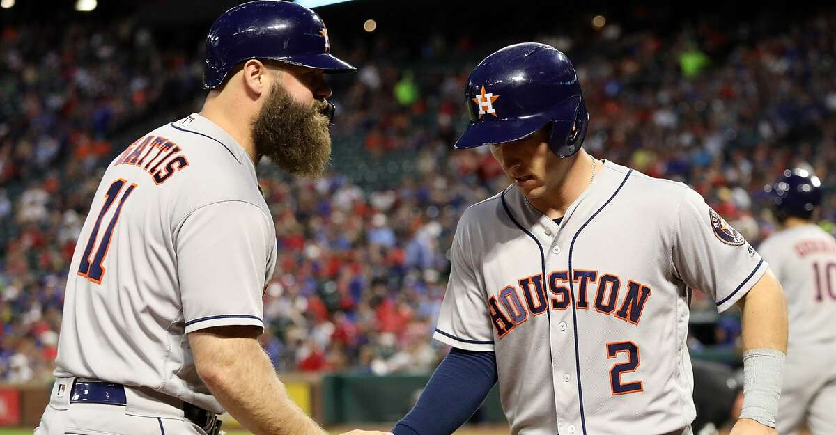 ARLINGTON, TX - JUNE 07: Evan Gattis #11 of the Houston Astros celebrates a run with Alex Bregman #2 in the fourth inning against the Texas Rangers at Globe Life Park in Arlington on June 7, 2018 in Arlington, Texas. (Photo by Ronald Martinez/Getty Images)