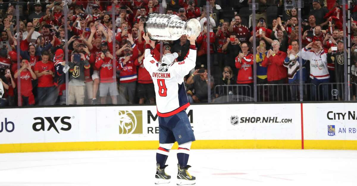 LAS VEGAS, NV - JUNE 07: Alex Ovechkin #8 of the Washington Capitals hoists the Stanley Cup after his team defeated the Vegas Golden Knights 4-3 in Game Five of the 2018 NHL Stanley Cup Final at T-Mobile Arena on June 7, 2018 in Las Vegas, Nevada. (Photo by Bruce Bennett/Getty Images)