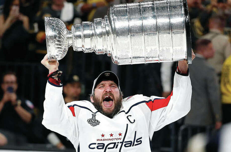 Washington Capitals left wing Alex Ovechkin hoists the Stanley Cup after the Capitals defeated the Golden Knights Thursday night in Game 5 of the Stanley Cup Finals in Las Vegas. Photo:       AP