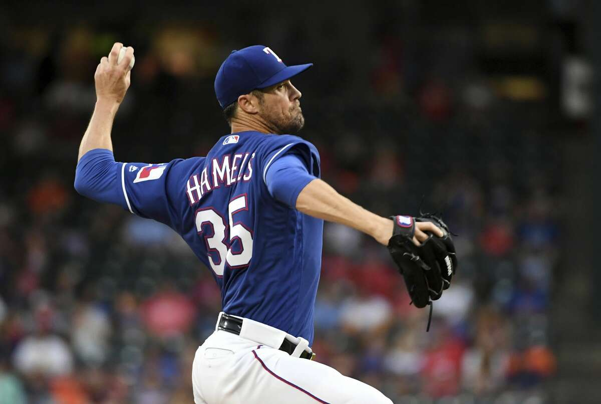 Texas Rangers starting pitcher Cole Hamels (35) works against the Houston Astros during the first inning of a baseball game Thursday, June 7, 2018, in Arlington, Texas. (AP Photo/Jeffrey McWhorter)