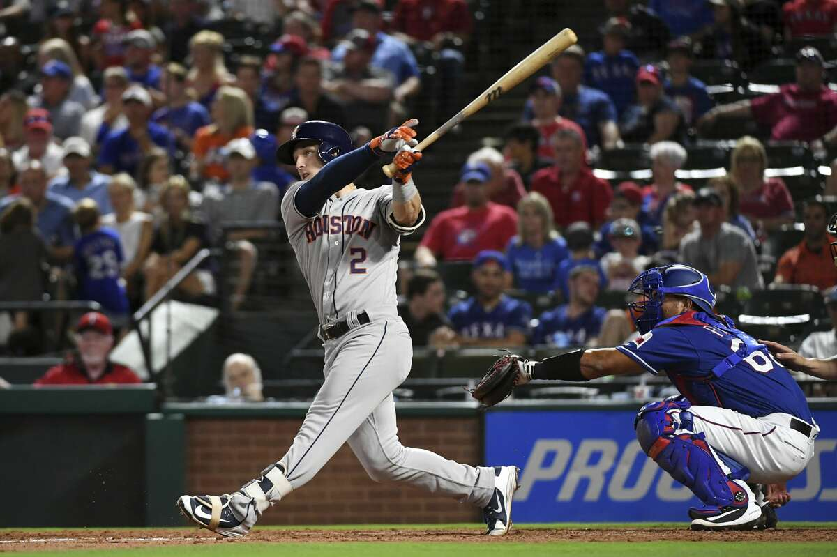 Houston Astros' Alex Bregman follows through on a solo home run off Texas Rangers starting pitcher Cole Hamels during the eighth inning of a baseball game Thursday, June 7, 2018, in Arlington, Texas. Houston won 5-2. (AP Photo/Jeffrey McWhorter)