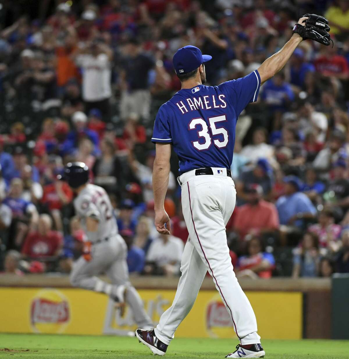 Texas Rangers starting pitcher Cole Hamels receives a new ball as Houston Astros' Alex Bregman rounds the bases on a solo home run during the eighth inning of a baseball game Thursday, June 7, 2018, in Arlington, Texas. Houston won 5-2. (AP Photo/Jeffrey McWhorter)