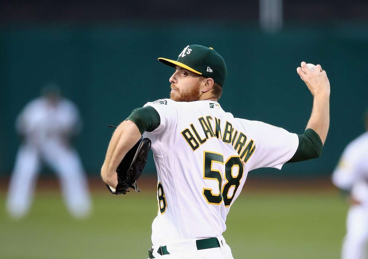 OAKLAND, CA - JUNE 07: Paul Blackburn #58 of the Oakland Athletics pitches against the Kansas City Royals in the first inning at Oakland Alameda Coliseum on June 7, 2018 in Oakland, California. (Photo by Ezra Shaw/Getty Images)