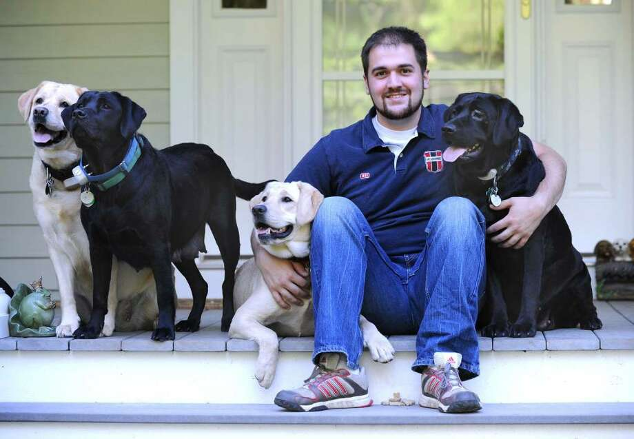 Mike Ammirata, of Redding, was honored this year as a Red Cross Hero. He's shown here with the four dogs he saved when his family home caught fire in Redding. Photo taken Friday, July 2, 2010. Photo: Carol Kaliff / The News-Times