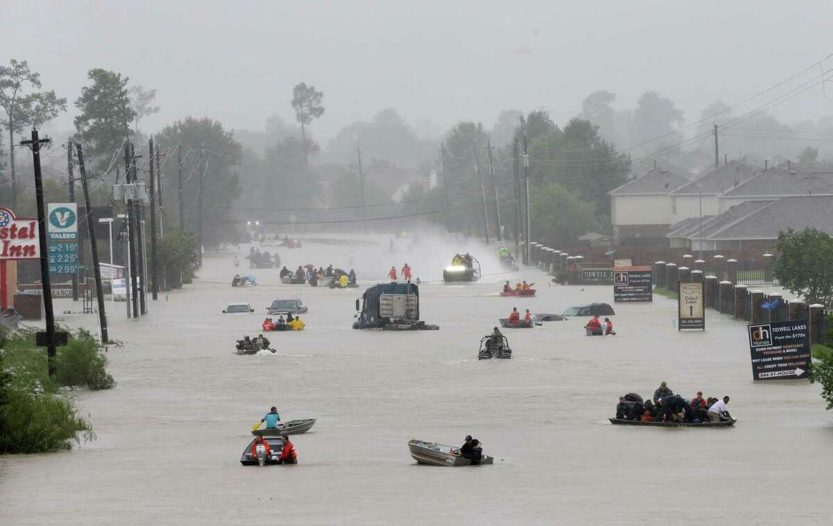 Rescue boats work along Tidwell at the east Sam Houston Tollway helping to evacuate people on August 28, 2017. Research suggests that precipitation during Hurricane Harvey in 2017 was about 8 to 19 percent more intense because of climate change, and caused about $125 billion in damage.