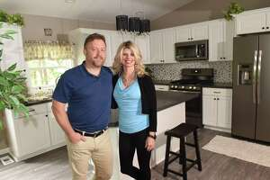 Glenn and Amber Schworm stand in a house they recently bought, renovated and will now sell on Tuesday, June 5, 2018 in Rotterdam, N.Y. (Lori Van Buren/Times Union)
