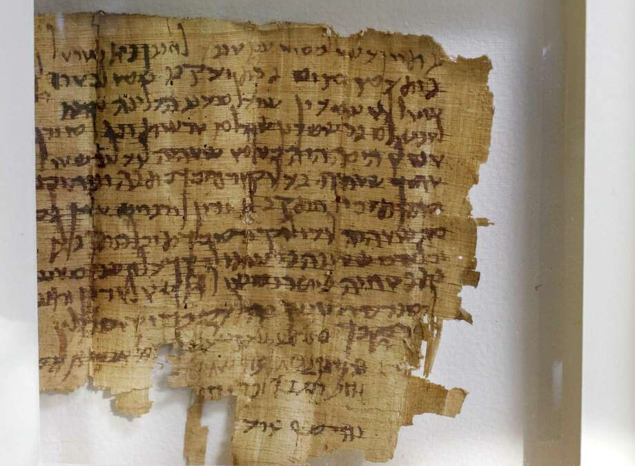 An ancient Hebrew document dated to the 2nd century A.D. is seen in Jerusalem on Wednesday, May 6, 2009. The document contains 15 lines of Hebrew characters of a type also used in the Dead Sea Scrolls, ancient holy books and apocalyptic treatises thought to have been collected by an ascetic Jewish sect two millennia ago, but is a a legal text apparently unrelated to the more famous scrolls. (AP Photo/Sebastian Scheiner) Photo: SEBASTIAN SCHEINER / AP / AP