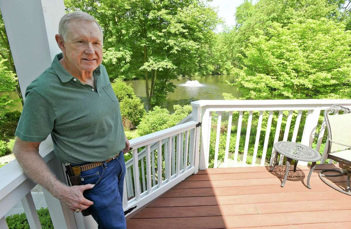 Hank Cuthbertson is photographed on May 30, 2018 at his home in Stamford, Connecticut. After losing a hard-fought plea for the city to turn down the Life Time gym in a Turn of River Office Park, which is across from his property that back up to Sterling Lake, neighbors of Cuthbertson are starting to petition this week for the Board of Representatives to overturn it.
