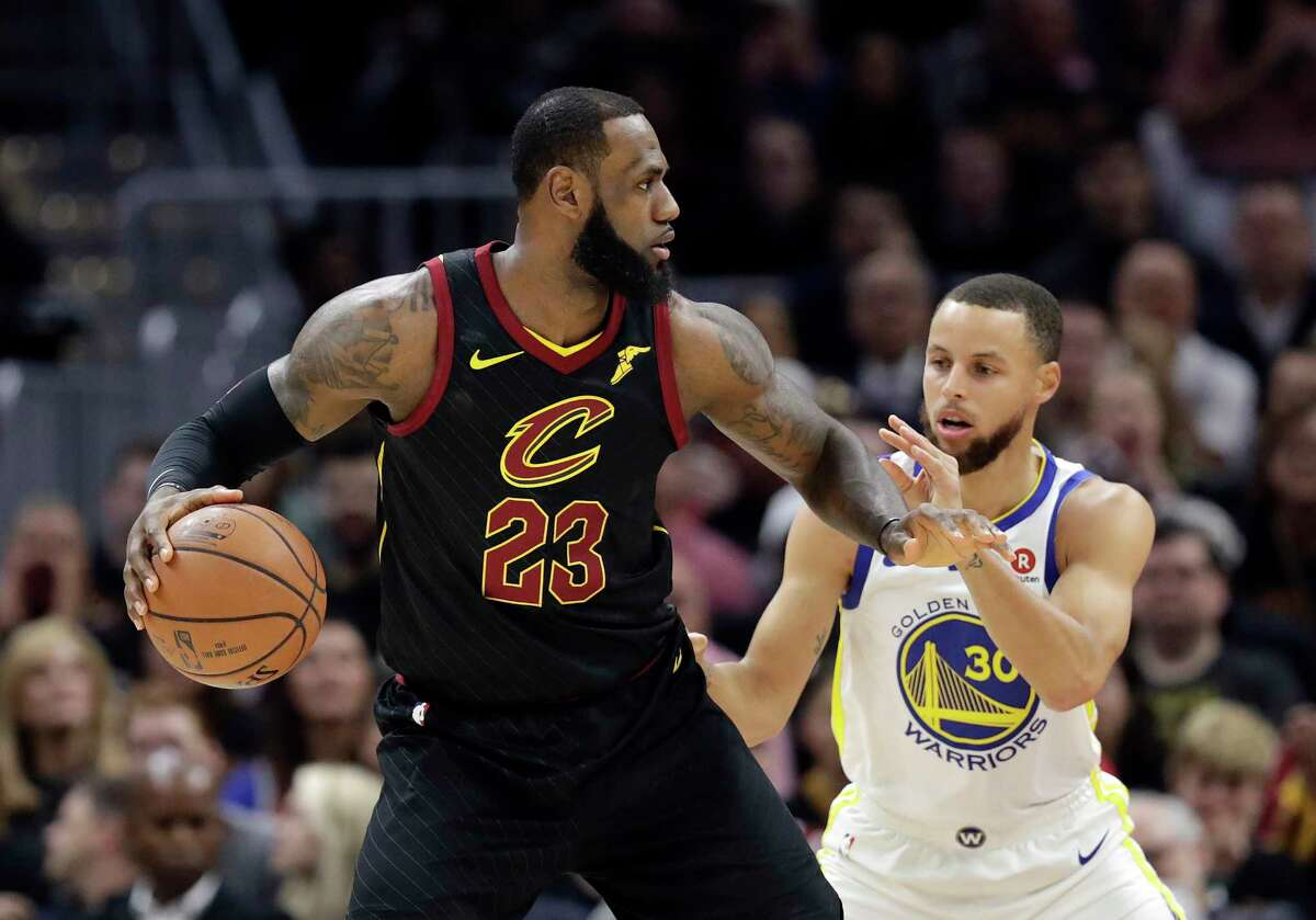 Cleveland Cavaliers' LeBron James is defended by Golden State Warriors' Stephen Curry in the first half of Game 3 of basketball's NBA Finals, Wednesday, June 6, 2018, in Cleveland. (AP Photo/Tony Dejak)