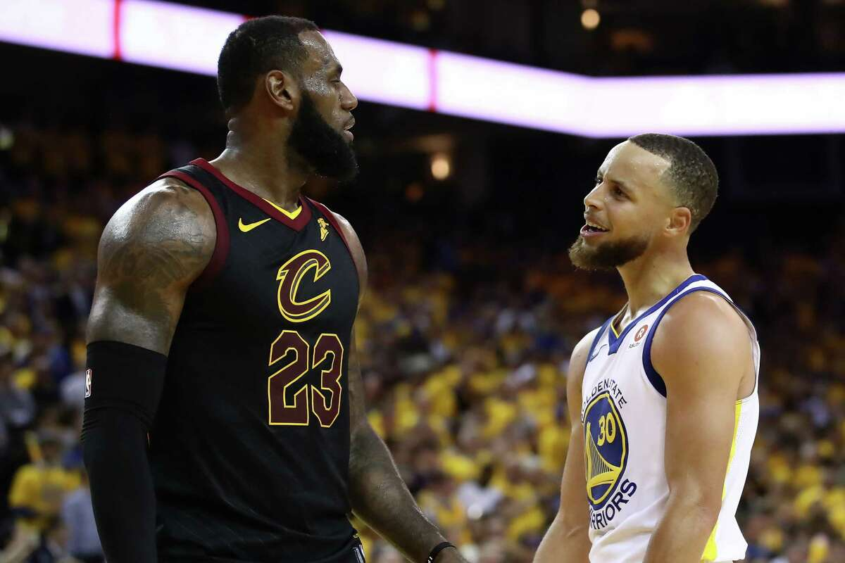 OAKLAND, CA - MAY 31: Stephen Curry #30 of the Golden State Warriors exchanges words with LeBron James #23 of the Cleveland Cavaliers in overtime during Game 1 of the 2018 NBA Finals at ORACLE Arena on May 31, 2018 in Oakland, California. NOTE TO USER: User expressly acknowledges and agrees that, by downloading and or using this photograph, User is consenting to the terms and conditions of the Getty Images License Agreement.